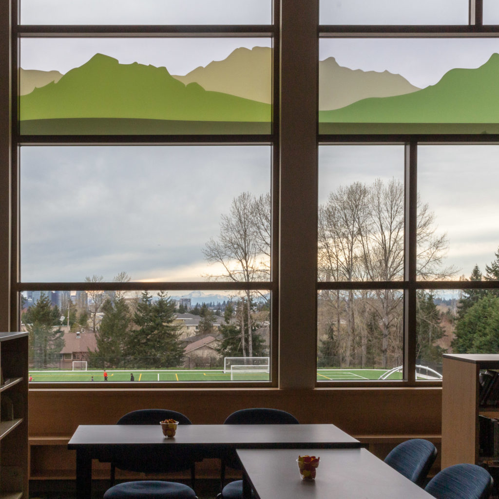 The view from the library with graphical elements of mountains on the windows.