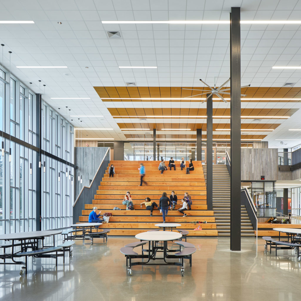 Students enjoy the grand staircase in the Juanita High School Commons.